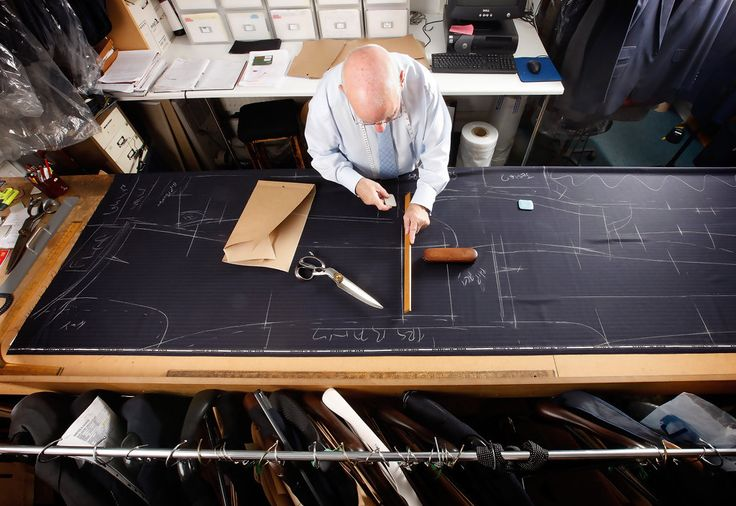 Bespoke Head Cutter Peter O'Neill marks out and cuts a suit pattern. A bespoke two-piece suit takes up to 8 weeks to make and starts at around $5,000 USD. Source: Dan Kitwood - Getty Images.